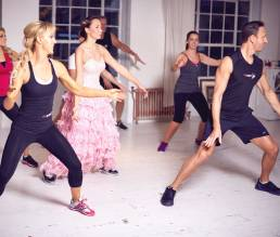 Ian and Natalie leading a FitSteps class